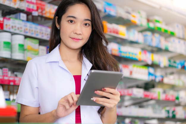 asian-female-pharmacist-uses-digital-tablet-pharmacy_51195-3832